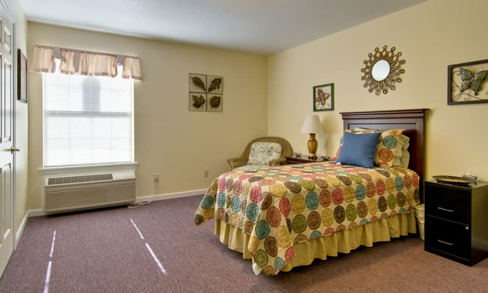 Large bedroom for assisted living residents at Asbury Cove in Ripley, Tennessee