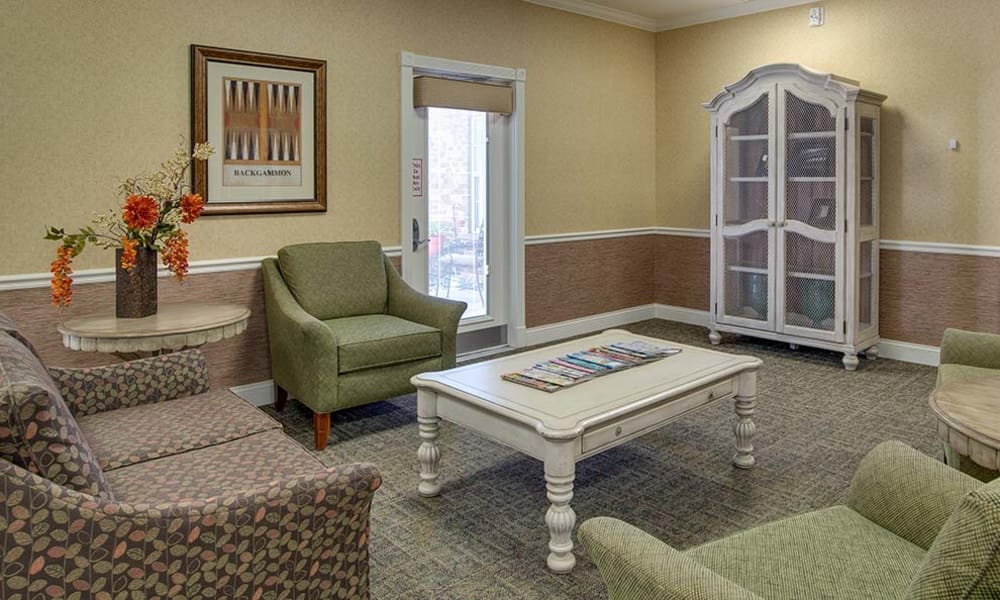Cozy fireplace in assisted living common area for residents at Auburn Creek Senior Living in Cape Girardeau, Missouri