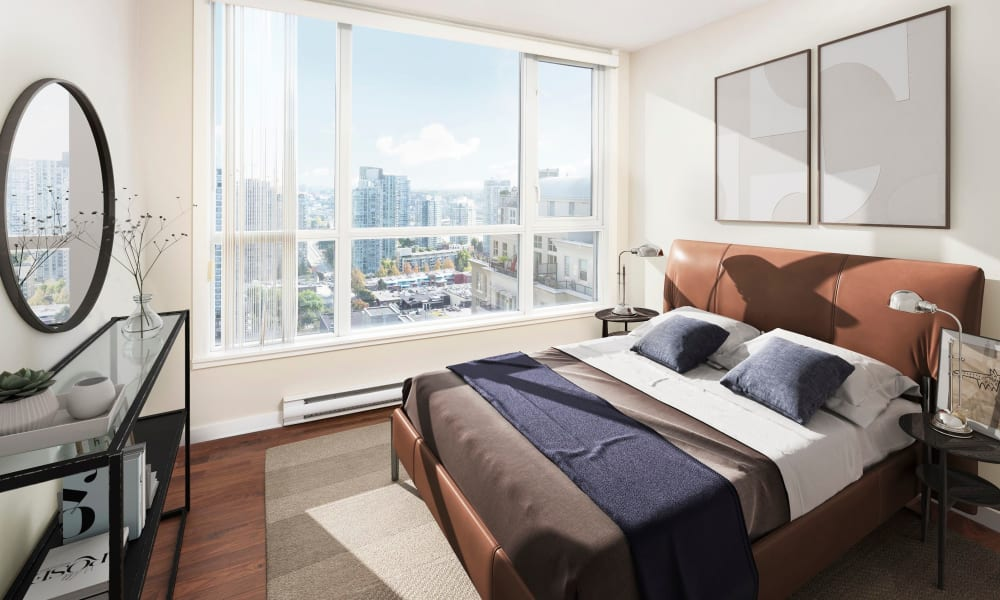 Gorgeous bedroom with mirror at Metropolitan Towers in Vancouver, British Columbia