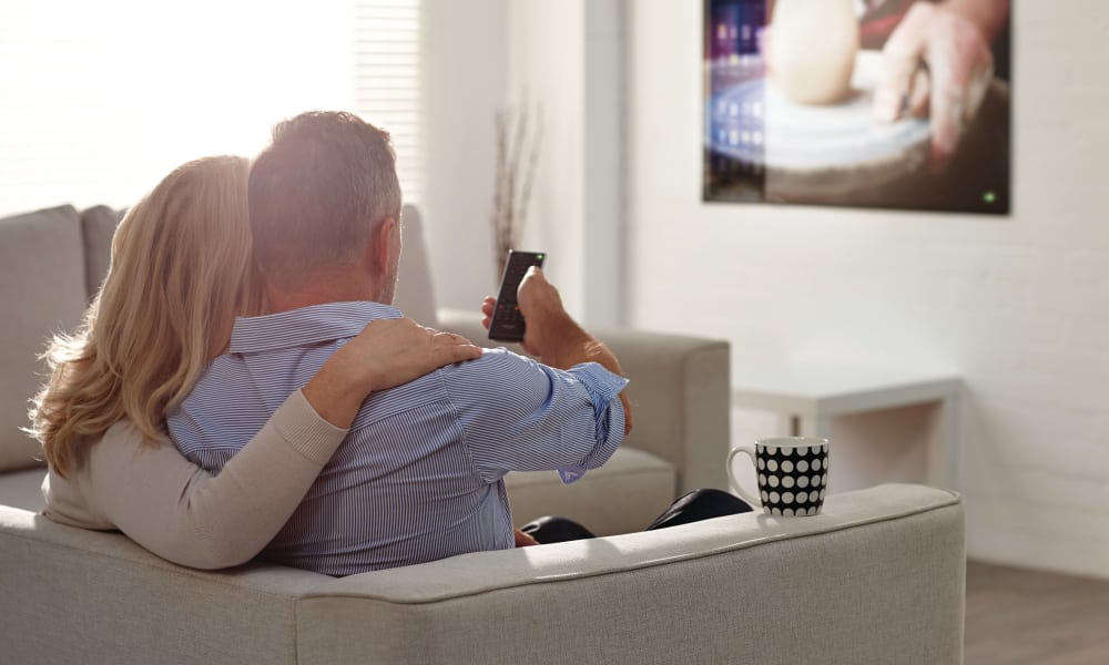 Couple watching TV at The Venue in Rochester, New York