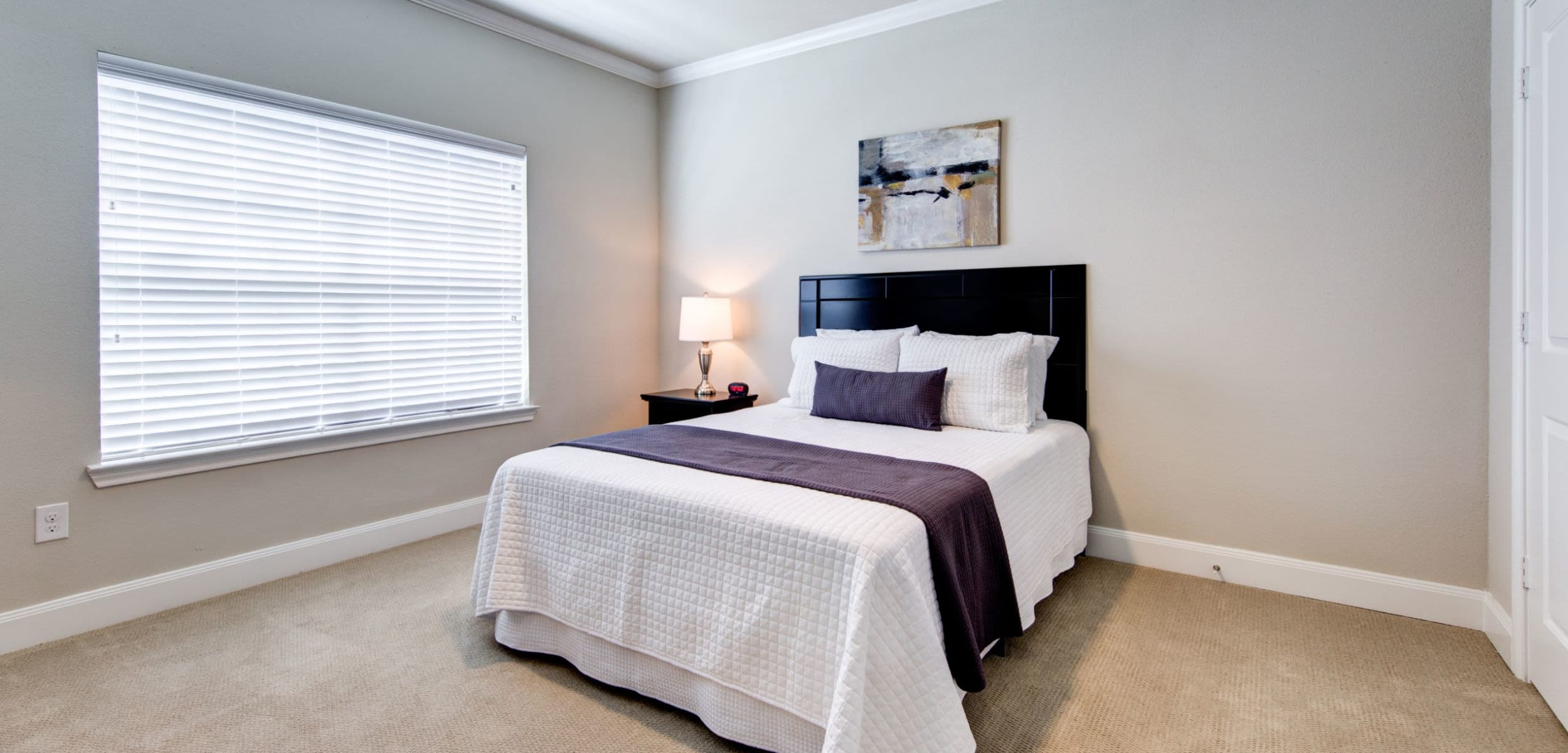Bedroom with a large window at Marquis on Memorial in Houston, Texas