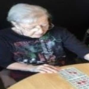 Resident Doris playing bingo at Prairie Meadows Senior Living in Kasson, Minnesota.