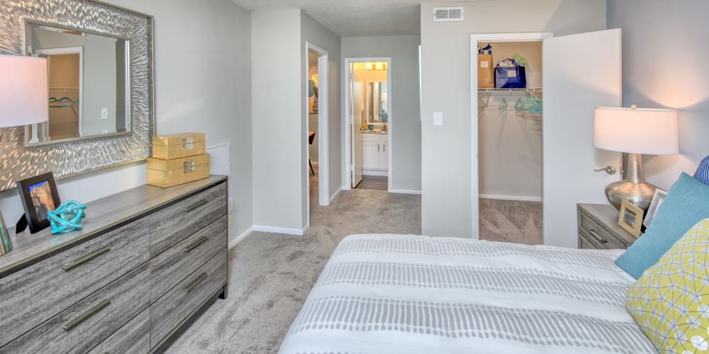 Well lit model bedroom with carpeted floors at The Madison in Charlotte, North Carolina