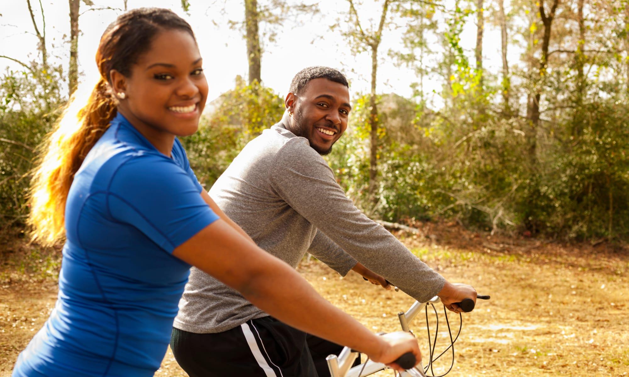 Two residents biking near The Retreat at Sherwood in Sherwood, Arkansas