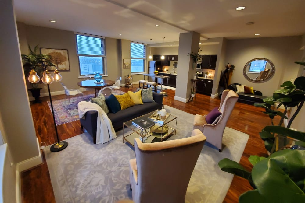 Well decorated spacious living space features ample natural light at The Reserve at 4th and Race in Cincinnati, Ohio