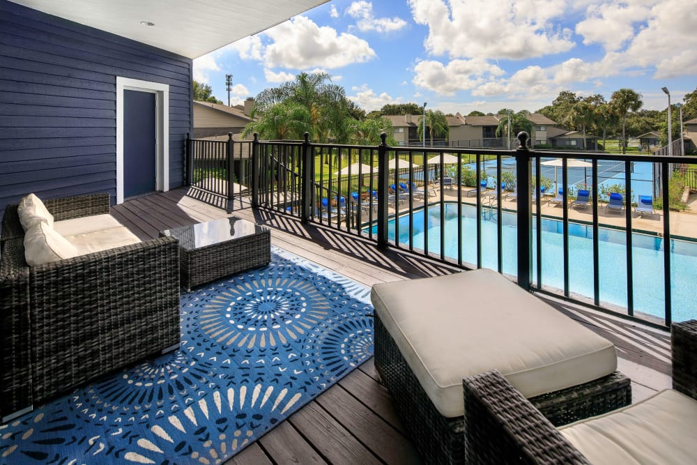 Outdoor lounge near the swimming pool at WestEnd At 76Ten in Tampa, Florida