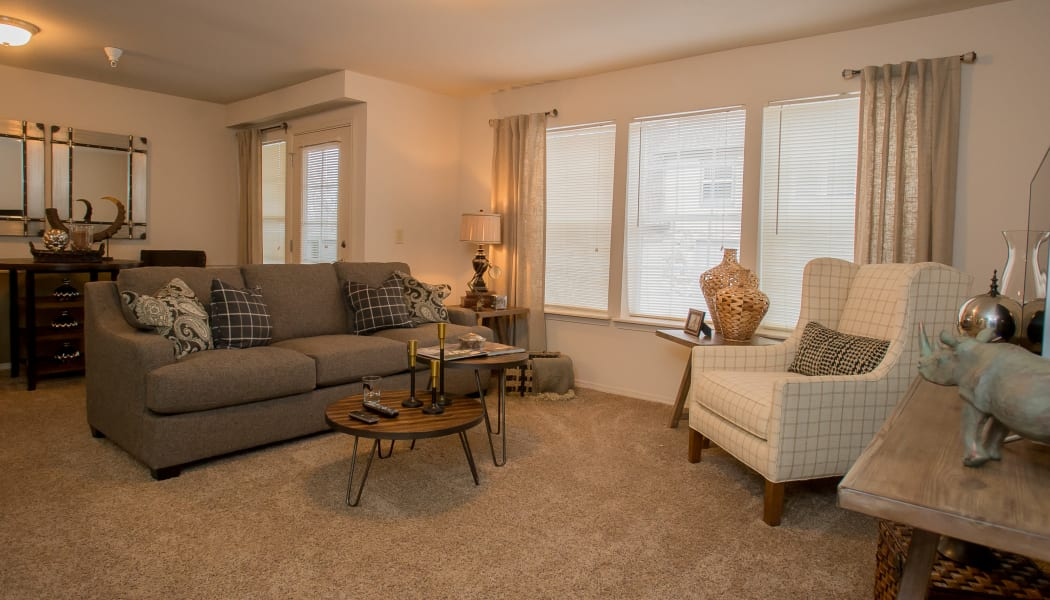 Large windows in the living room at Villas of Waterford Apartments in Wichita, Kansas