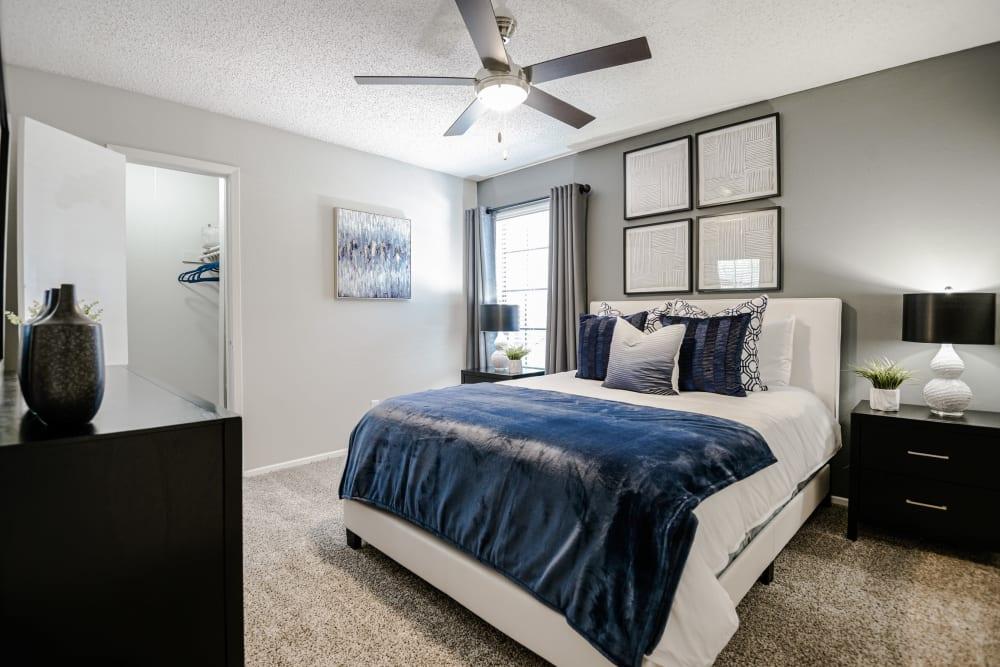 Well lit model bedroom at The Regent in Dallas, Texas