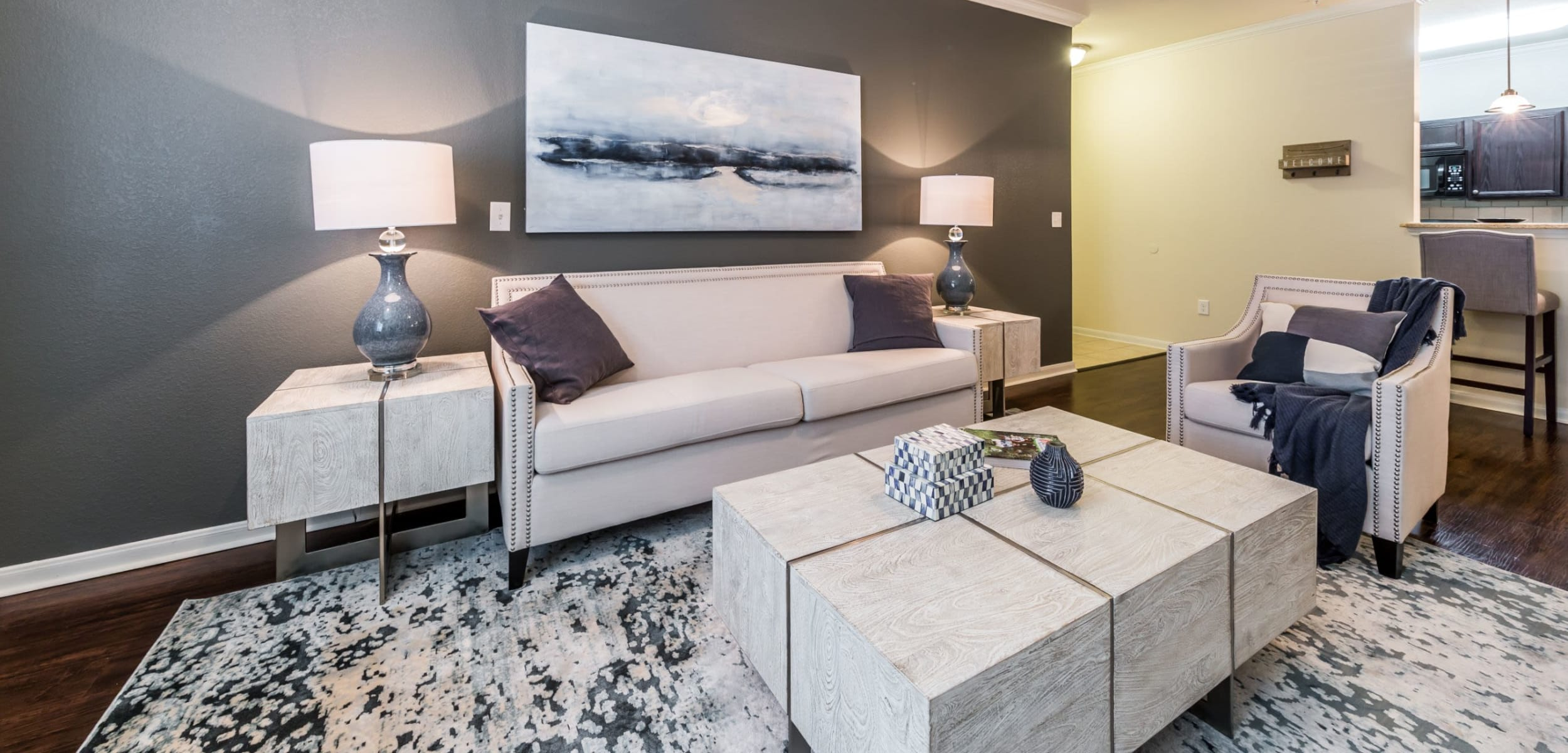 Living space with wood style floors at Marquis at The RIM in San Antonio, Texas