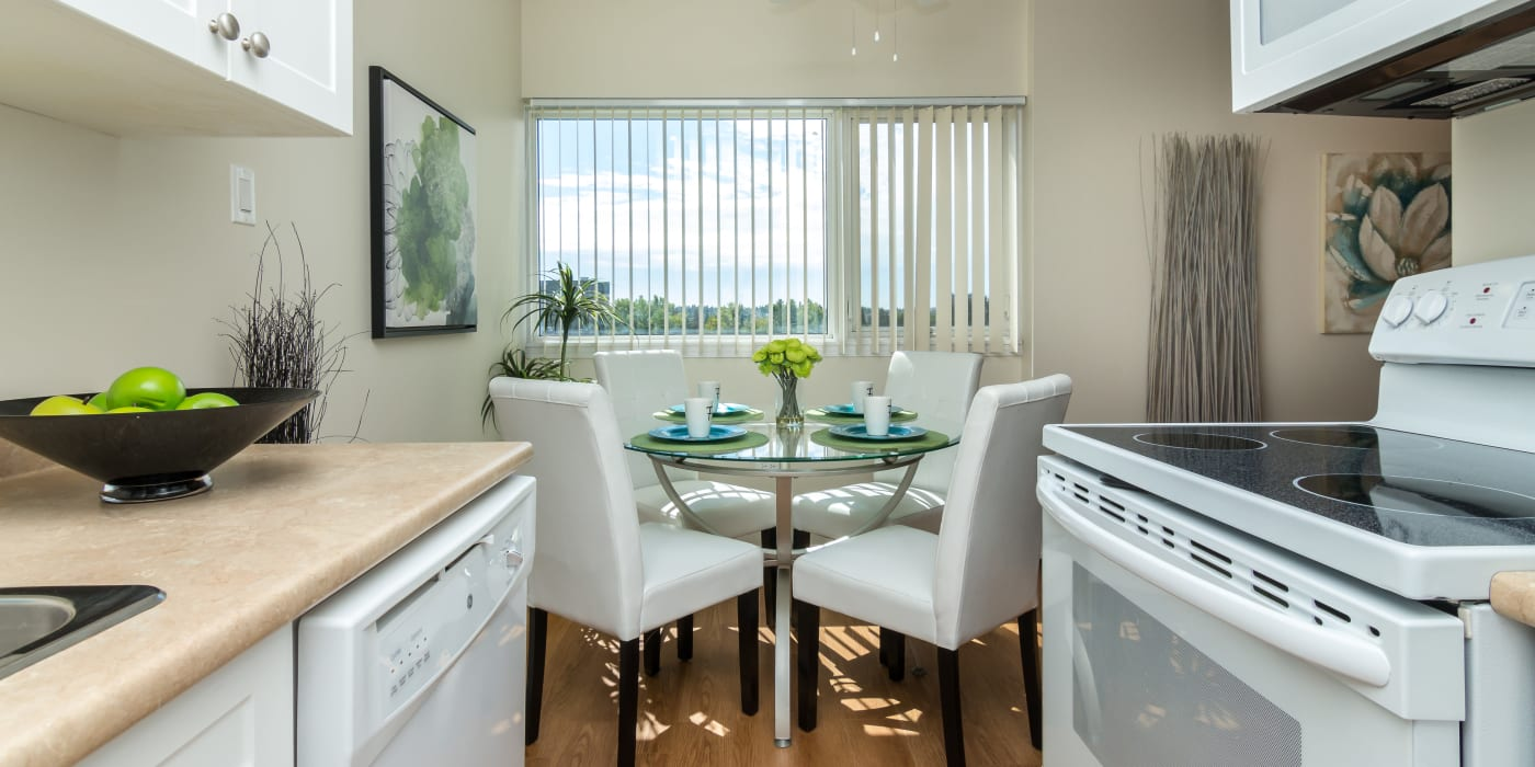 Modern kitchen and dining area at Glenmore Heights apartments