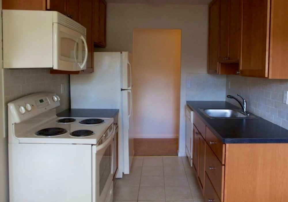 Kitchen with tile style flooring at Sharon Arms Apartments in Robbinsville, New Jersey