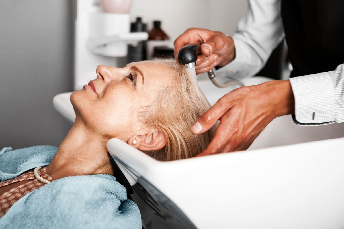 Resident receiving salon services at The Blake at The Grove in Baton Rouge, Louisiana.