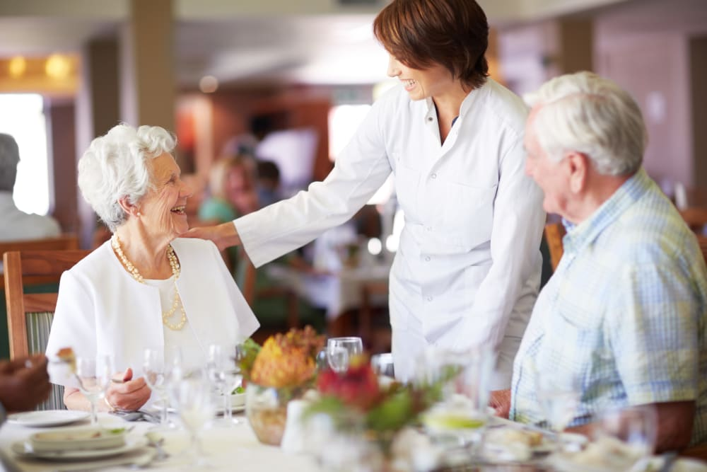 Chef interacting with seniors at mealtime