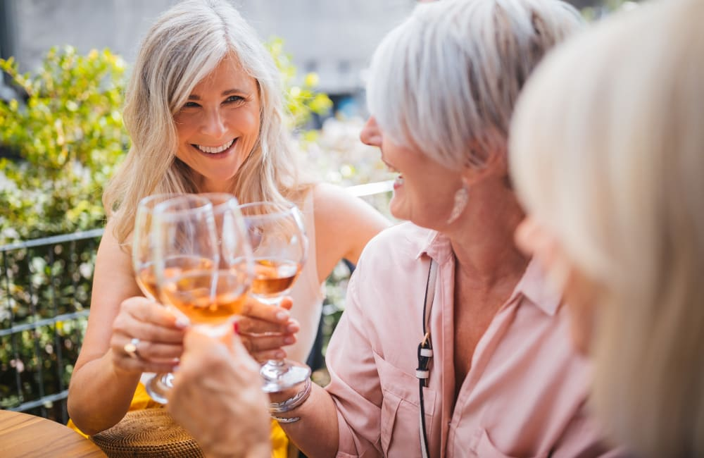 Residents drinking wine outside at Quail Park of Lynnwood in Lynnwood, Washington
