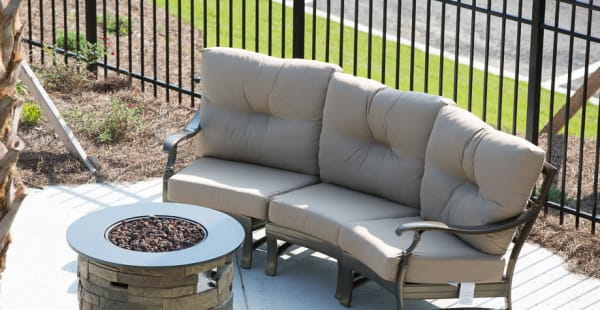 Comfortable seating around a firepit at Ansley Commons Apartment Homes in Ladson, South Carolina
