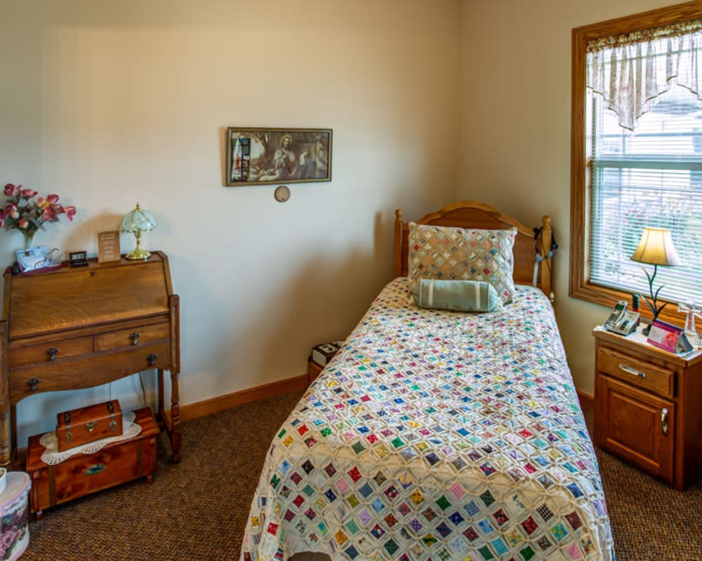 Cozy resident bedroom at SunnyBrook Carroll in Carroll, Iowa.