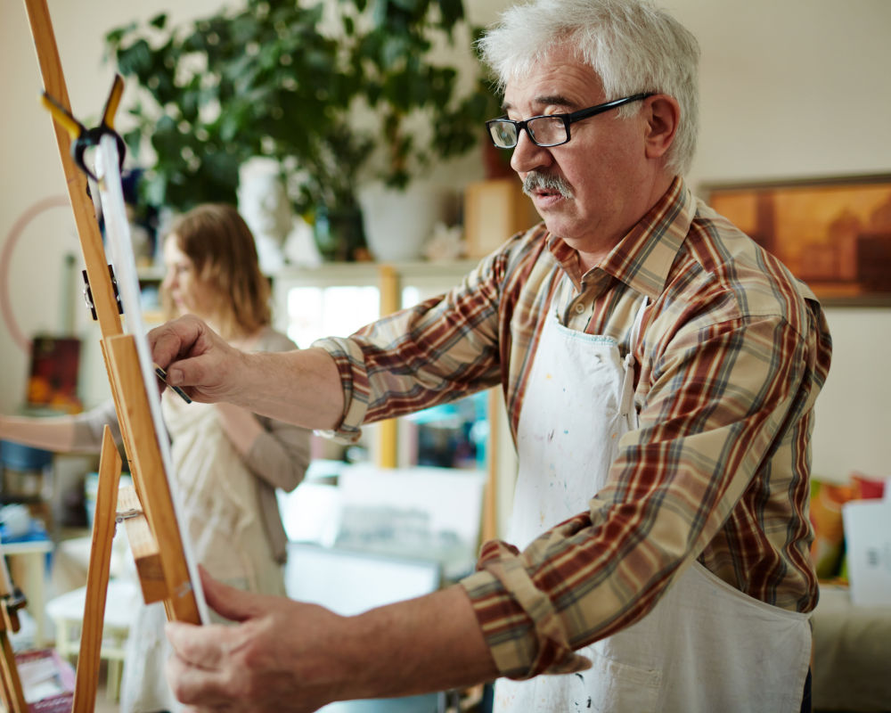 Seniors painting at Seven Lakes Memory Care in Loveland, Colorado