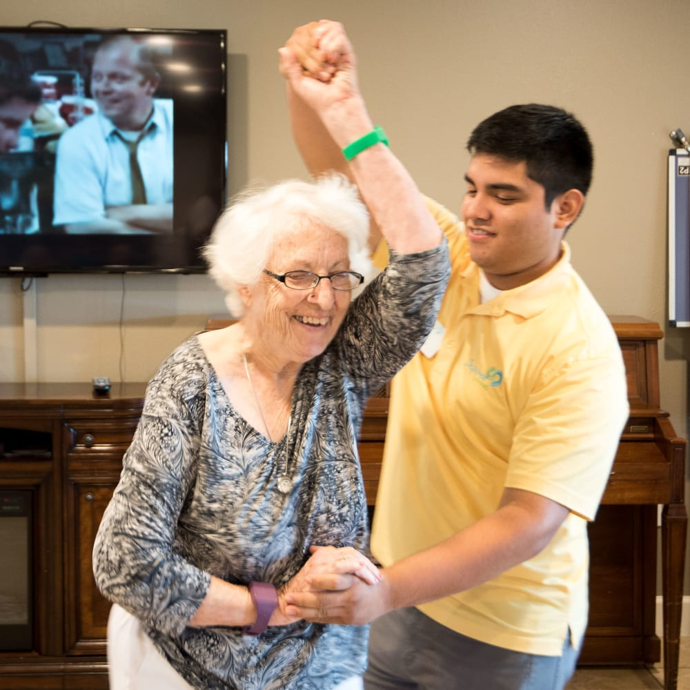 Resident and staff member dance at Inspired Living in Ocoee, Florida