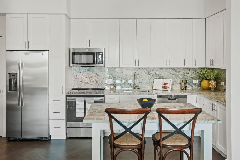 Modern kitchen with European style cabinets and stainless steel appliances at Town Lantana in Lantana, Florida