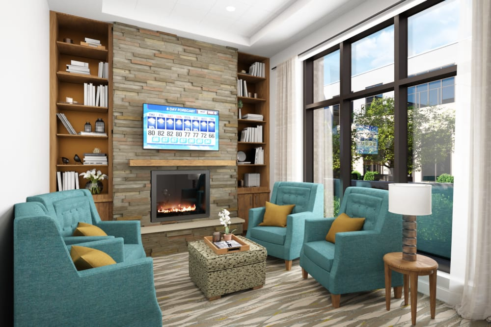 Seating area with a fireplace at Anthology of Mayfield Heights - OPENING 2020 in Mayfield Heights, Ohio