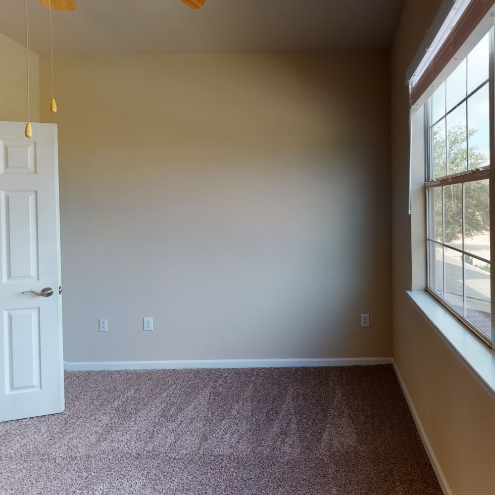 Open-concept layout with carpeted flooring throughout the bedrooms of a townhome at Oaks Estates of Coppell in Coppell, Texas