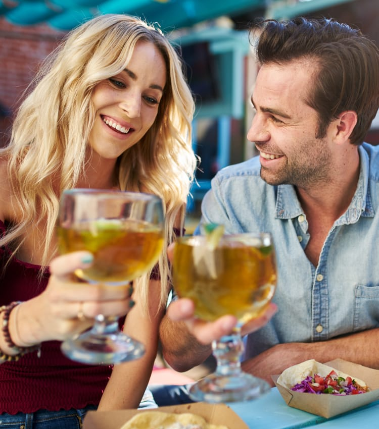 Couple from The Jaxon enjoying cocktails at nearby restaurant