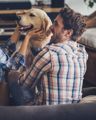 Family with dog at Maple Bay Townhomes in Virginia Beach, Virginia