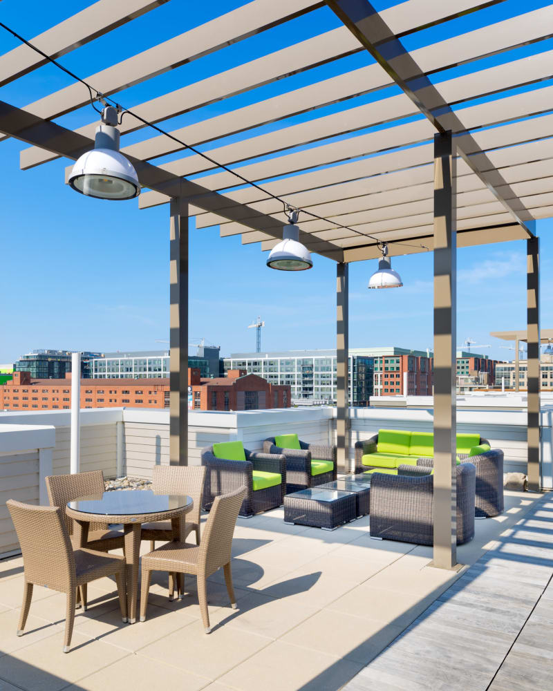 Arbor providing partial shade over the rooftop lounge at The Bixby in Washington, District of Columbia