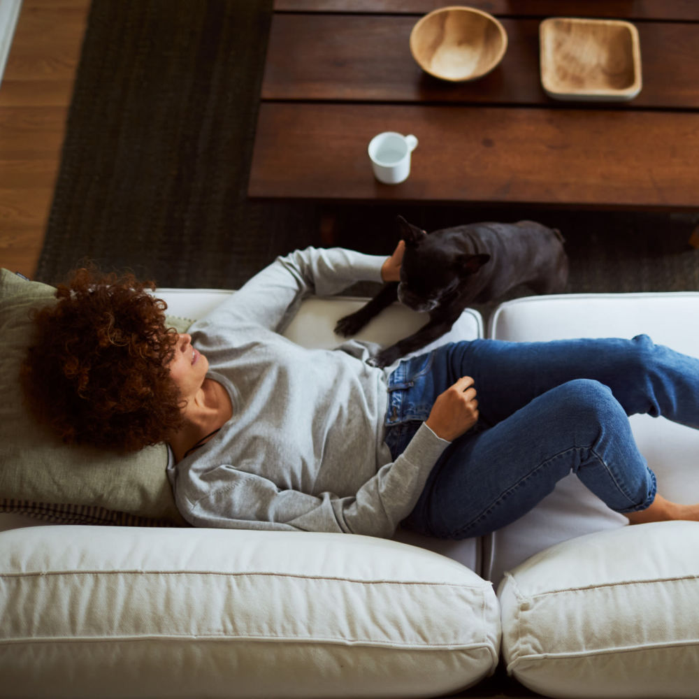 Resident and her pup relaxing in their apartment home at Overlook Point Apartments in Salt Lake City, Utah