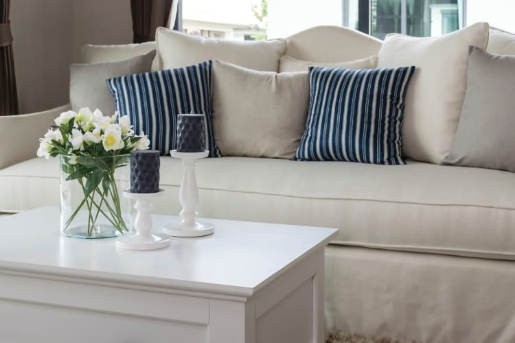 Beautiful couch in model living room at The Elms of Bloomfield in Bloomfield, New York