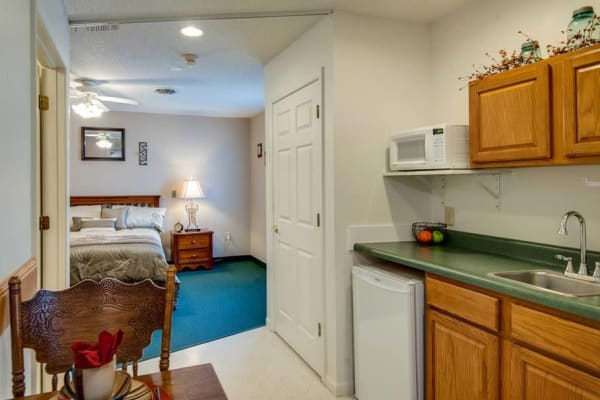 Assisted living apartment kitchen at Victorian Place of Union in Union, Missouri