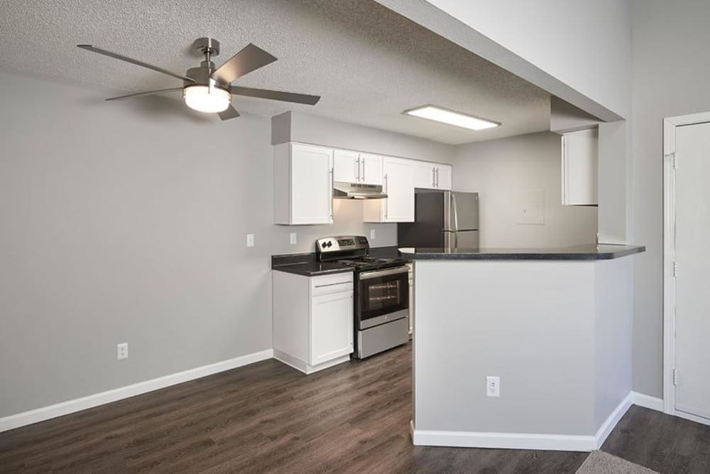White Kitchen Room at Alton Green Apartments in Denver, CO