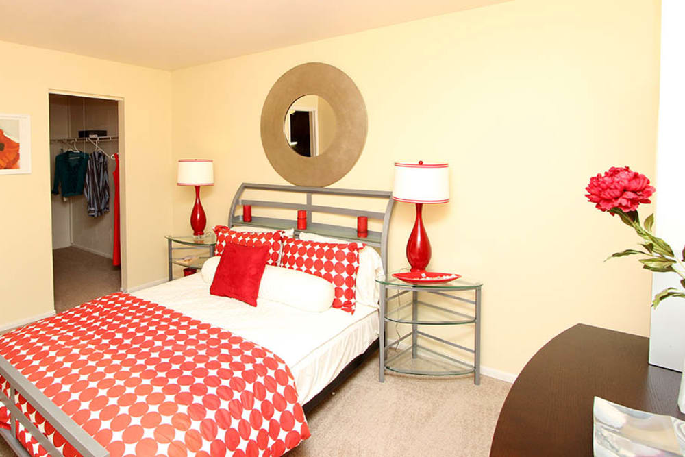 A furnished, brightly lit bedroom at Riverstone Apartments in Bolingbrook, Illinois