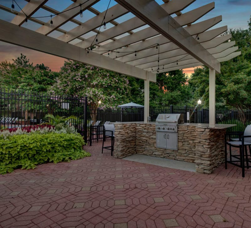 Outdoor grilling area at Woodway at Trinity Centre in Centreville, Virginia
