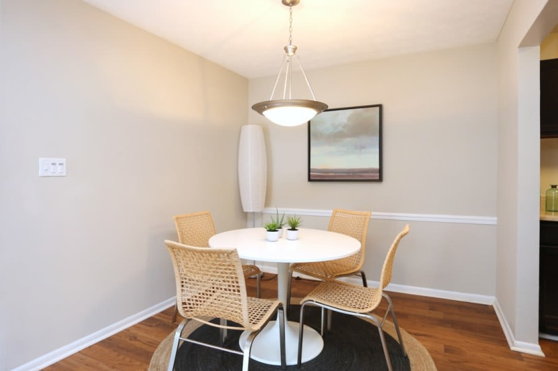 Dining nook with a custom chandelier in a model apartment at The Everette at East Cobb in Marietta, Georgia