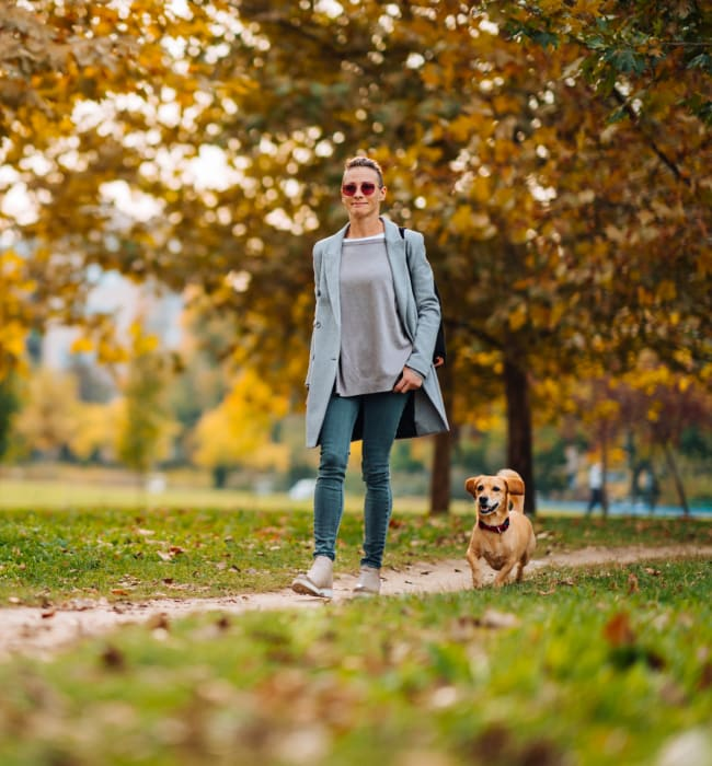 Resident walking her dog near Anthem on 12th in Seattle, Washington