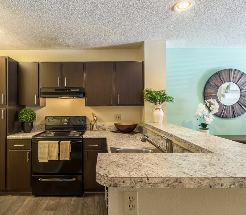 Fully equipped kitchen with granite counters at Britton Woods in Dublin, Ohio