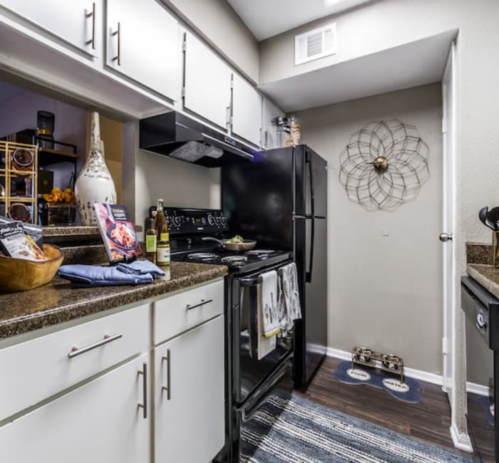 Fully equipped kitchen at 2400 Briarwest in Houston, Texas