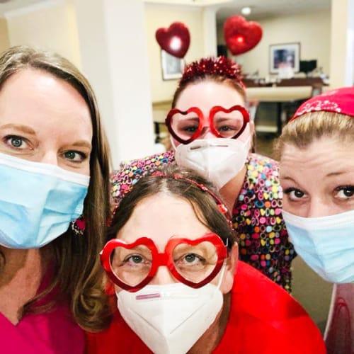 Caregivers with resident celebrating valentines day at Madison House in Norfolk, Nebraska