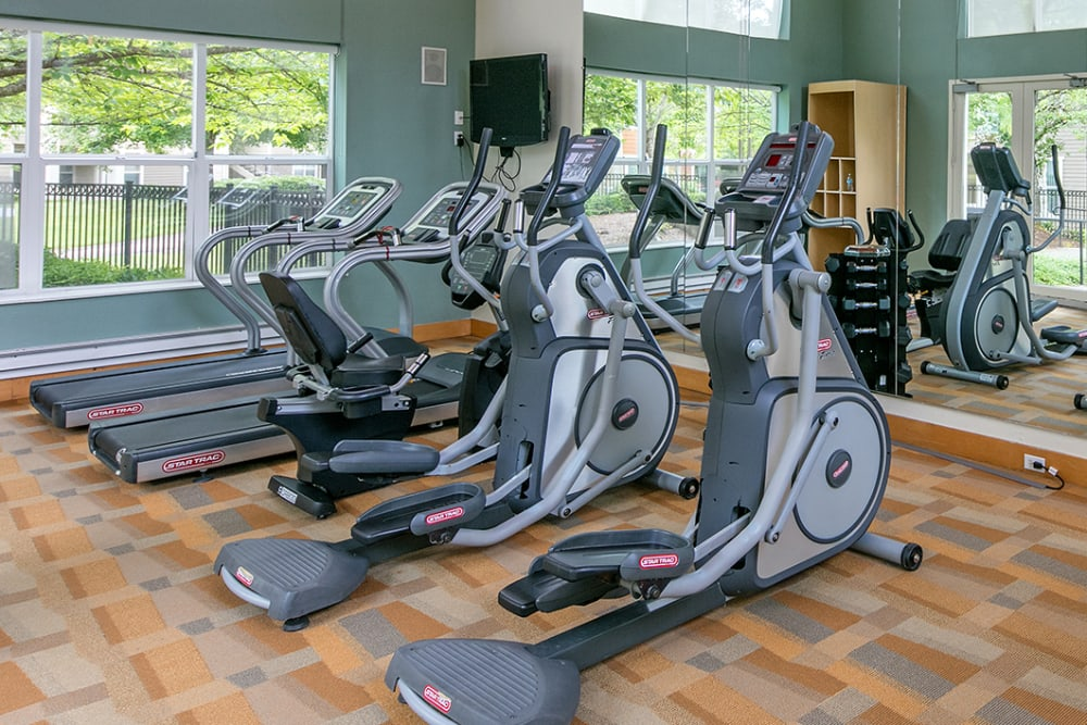 Fitness center with plenty of workout stations at Center Pointe Apartment Homes in Beaverton, Oregon