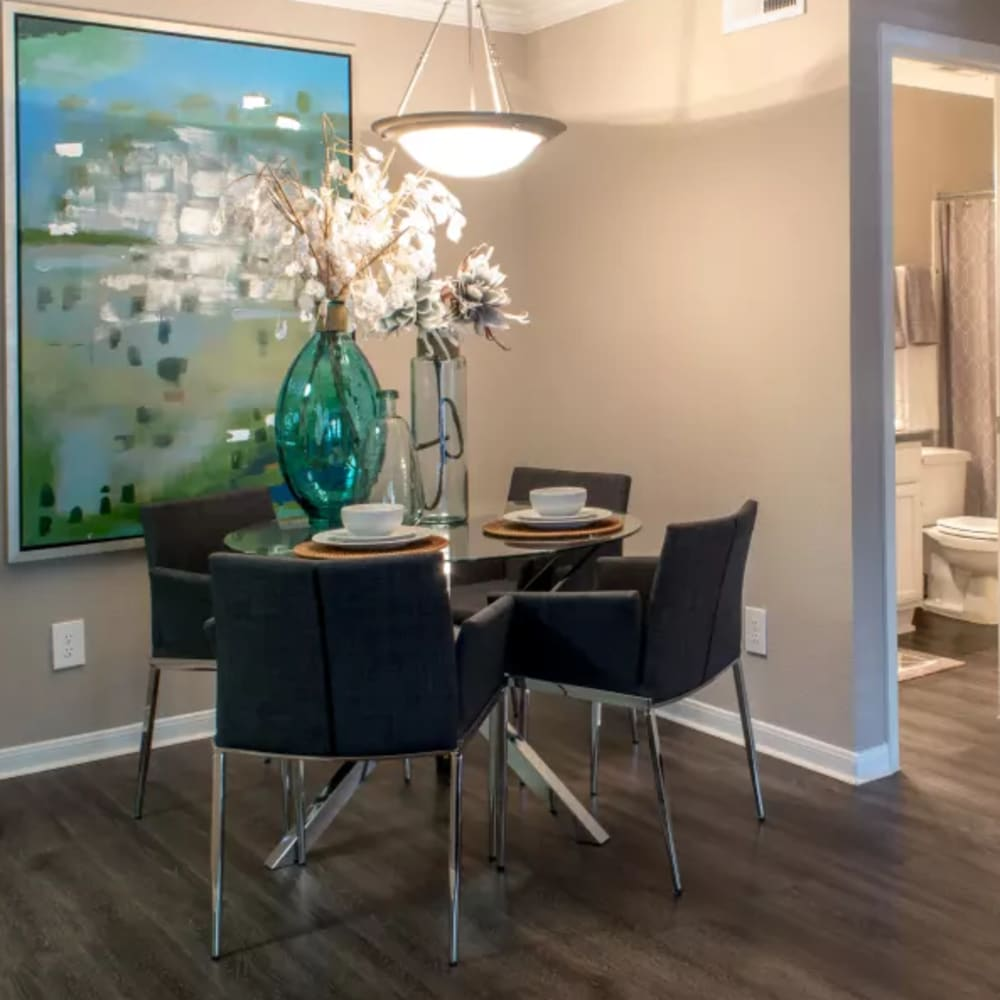 Contemporary dining room with wooden floors at Hayden at Enclave in Houston, Texas