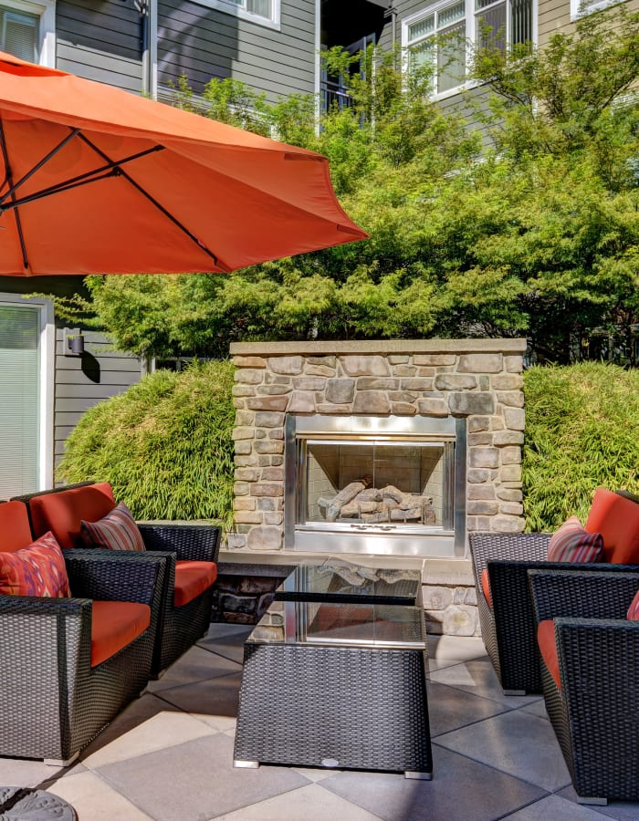 Outdoor fireplace at Chateau Woods Apartments