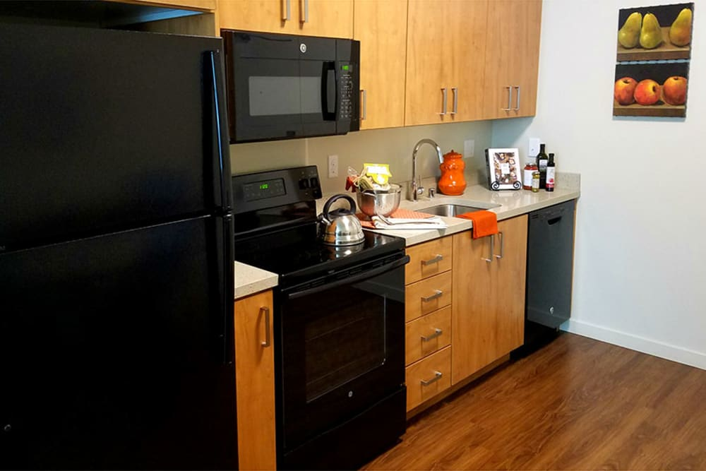 Kitchen with beautiful hardwood floors at The Lofts at Glenwood Place in Vancouver, Washington