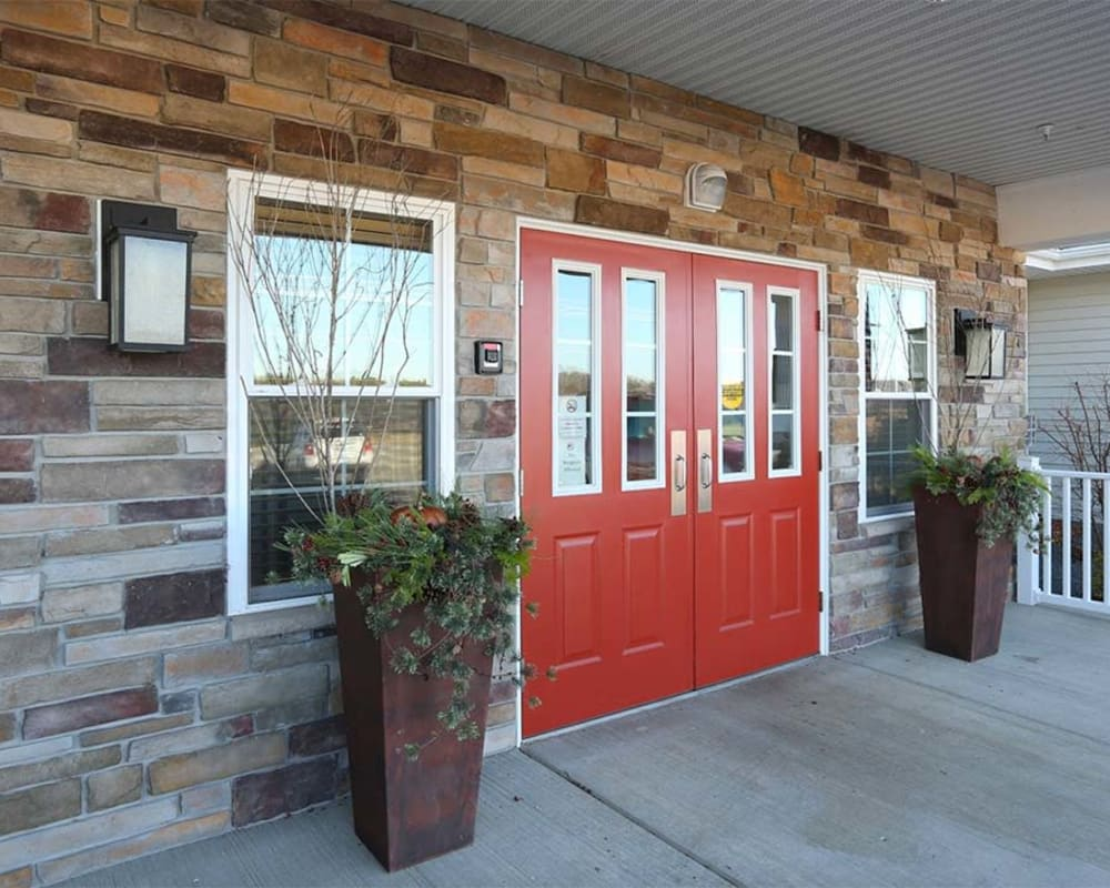 Main entrance and planters at Milestone Senior Living in Cross Plains, Wisconsin.