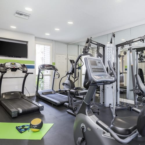 View virtual tour of our fitness center at Enclave at Lake Ellenor in Orlando, Florida
