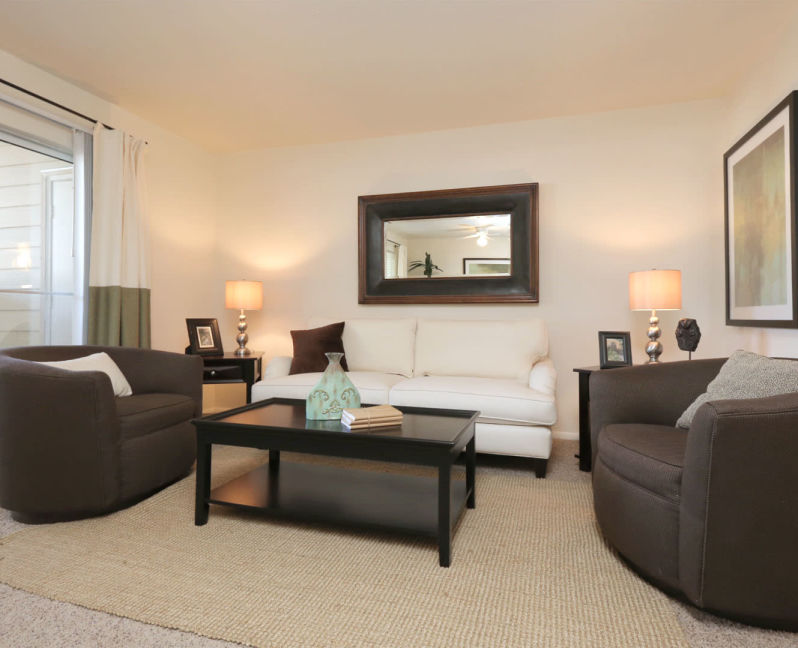 Comfortably decorated living area in a model home at Overlook Point Apartments in Salt Lake City, Utah
