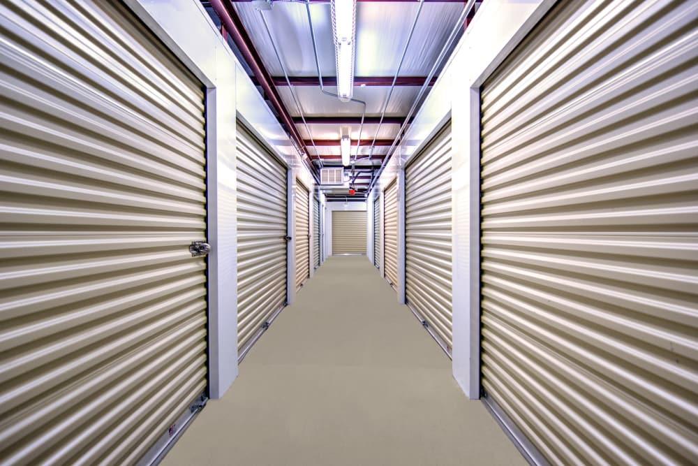 Hallway of indoor storage units at Prime Storage in Dallas, Georgia