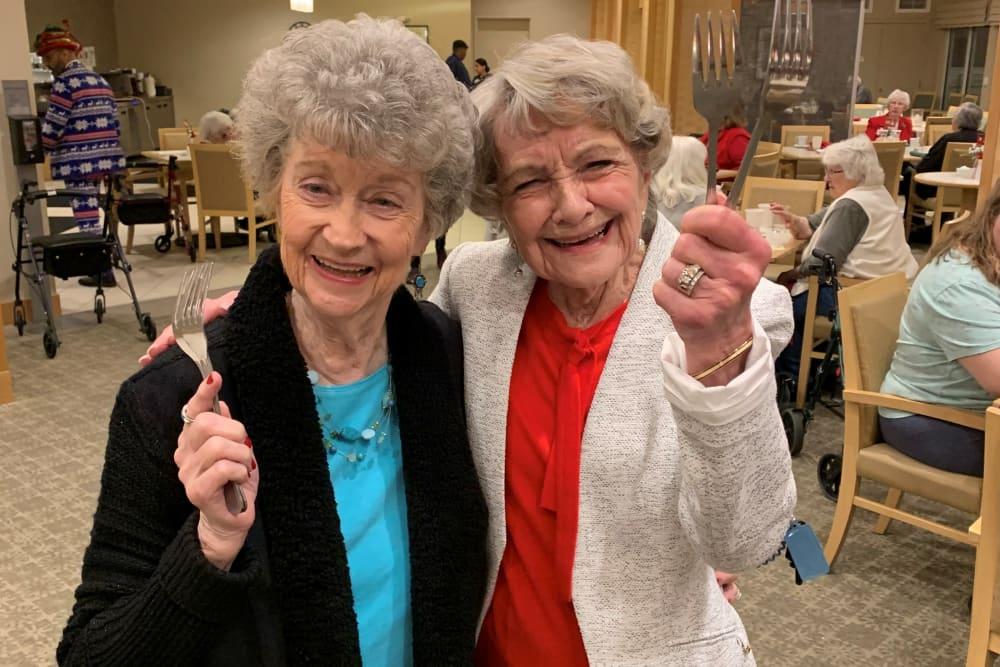 Two ladies ready to eat at Merrill Gardens at Auburn in Auburn, Washington.