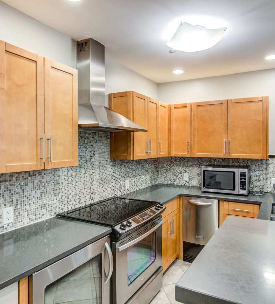 Large kitchen area in a model home at Sofi Parc Grove in Stamford, Connecticut