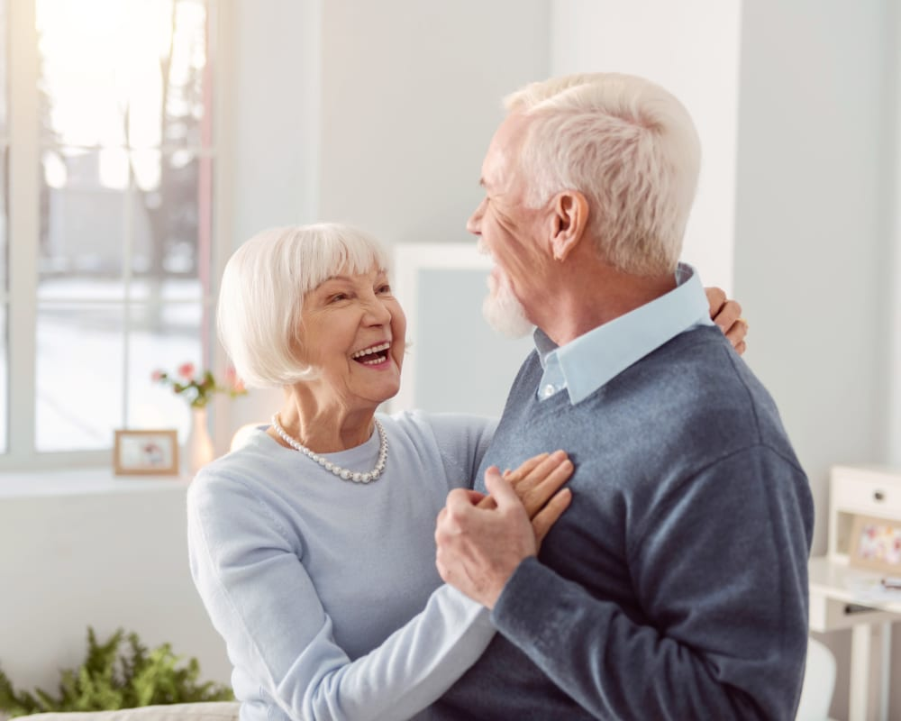 Couple dancing in their Independent Living apartment at Sunset Park Place in Dubuque, Iowa.